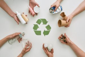 Top,View,Of,Many,Hands,Holding,Different,Waste,,Garbage,Types